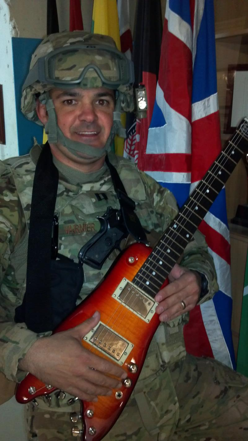Captian V with his Rambler Travel Guitar in Afghanistan