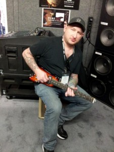 Josh Smith with his Strobel Rambler® Travel Guitar at NAMM 2014