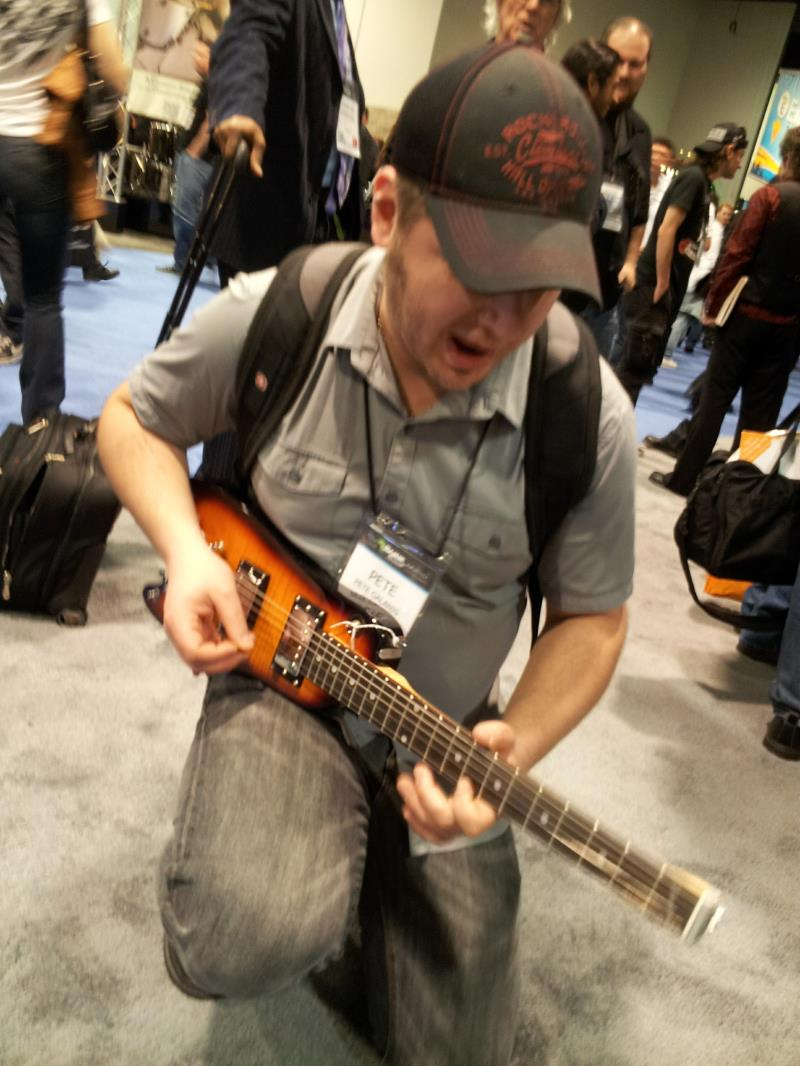 Pete G. checking out the Rambler Guitar at NAMM
