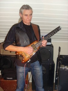 Rambler Professional Electric Travel Guitar at band practice