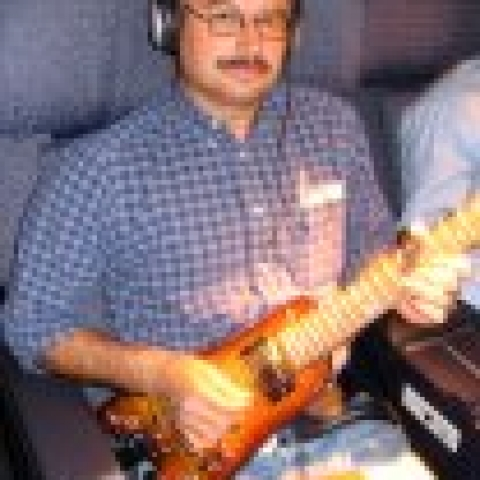 Jammin' in first class with a Rambler Travel Guitar