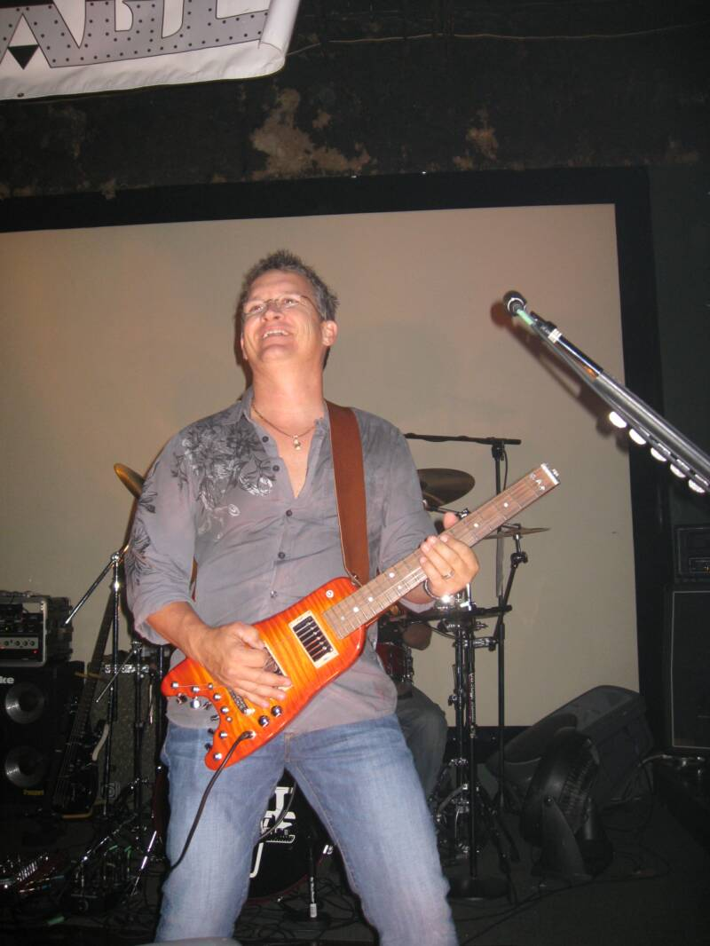 Scott with Split Image playing a Custom Rambler Portable Guitar