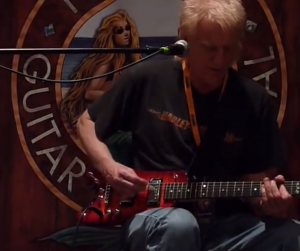 Ramlber Electric Travel Guitar on stage with Roger Heath