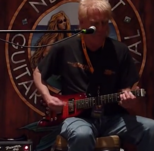 Roger Heath performing with is Rambler Portable Guitar
