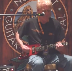 Roger Heath on stage with his Rambler Professional Travel Guitar