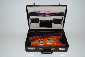 Rambler® travel guitar stowable in a briefcase