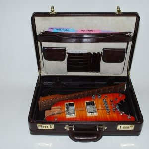 TangerineBurst Rambler™ ready to travel stowable in a briefcase