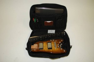 Tobacco Sunburst Professional Electric Travel Guitar in a computer bag