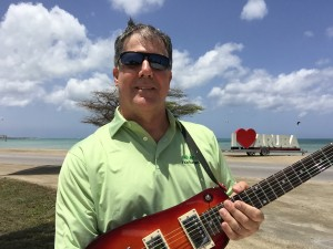 Brett with his Rambler Travel Guitar in Aruba