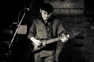 Darren Fallas with Rambler Travel Guitar in Memphis