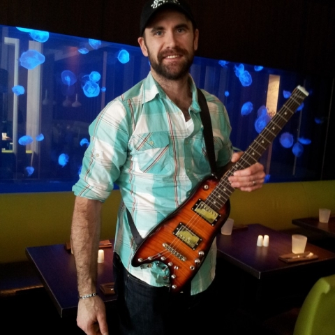 Jay Harrison of Winnepeg Jets trying out his new Rambler Travel Guitar