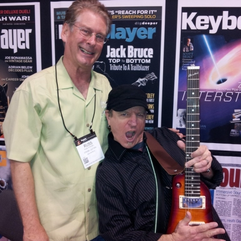 Mike Molenda from Guitar Player hamming it up with a Rambler Travel Guitar