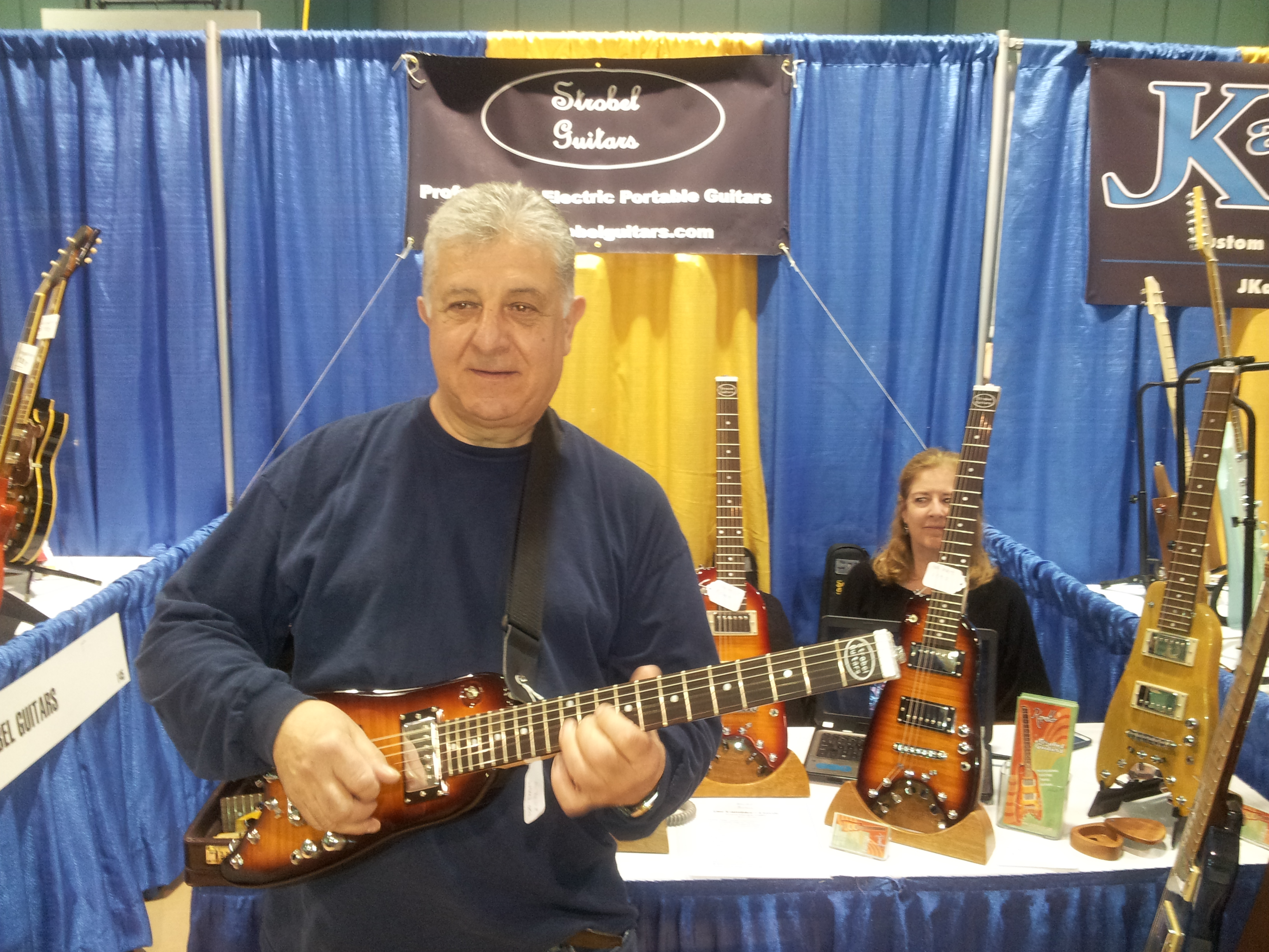Rudy checking out a Rambler portable guitar at Long Island Guitar Show