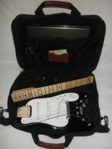 Strobelcaster in Computer Bag