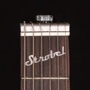 Rambler Travel Guitar patented StringKeeper