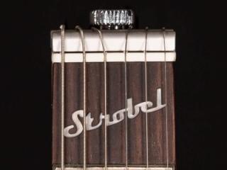 Rambler Travel Guitar patented StringKeeper