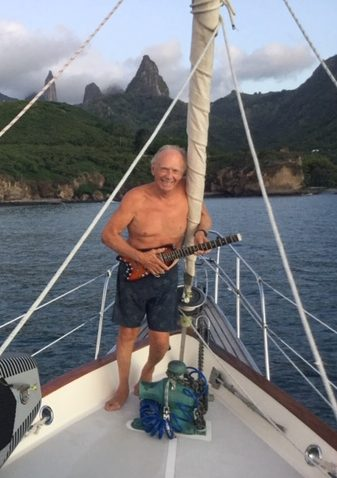 Rusty sailing with his Rambler Travel Guitar
